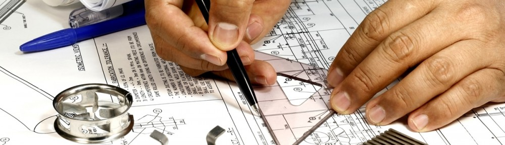 A photo of an Architect reviewing the engineer's drawings